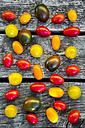 Colorful mini tomatoes on wood - SARF002189