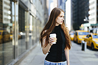 USA, New York City, portrait of young woman with coffee to go - GIOF000266