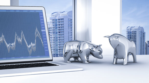 Bull and bear on desk with stock chart on laptop - AHUF000050