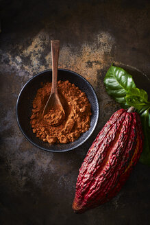 Cocoa pod and bowl of cocoa on rusty ground - KSWF001633
