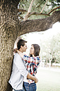 Young couple in love hugging in a park - JRFF000122
