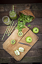 Two glasses of apple kiwi spinach smoothie and ingredients - LVF003971