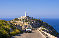 Spain, Mallorca, Cap Formentor lighthouse, car driving on road - AM004323