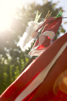 Santa costume handing on clothes line to dry - MIDF000698