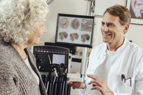 Senior patient getting prescription medication from doctor - MFF002281