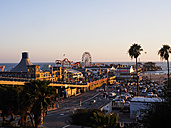 USA, Los Angeles, Santa Monica Beach Pier and Pacific Park at sunset - SBDF002309