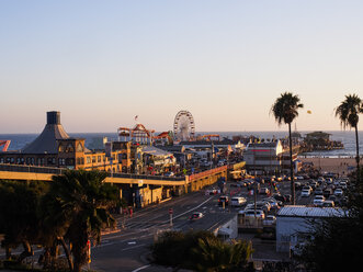 USA, Los Angeles, Santa Monica Beach Pier and Pacific Park at sunset - SBDF002309