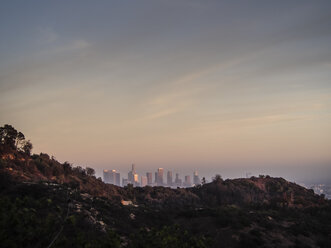 USA, Los Angeles, view to city skyline at sunset - SBDF002312
