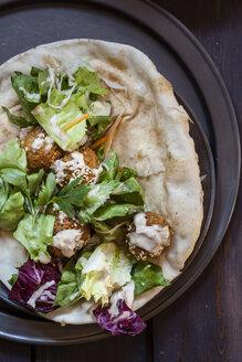 Homemade falafel with salad, tahini sauce on flat bread - SBDF002353
