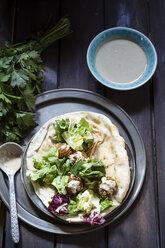 Homemade falafel with salad, tahini sauce on flat bread - SBDF002362