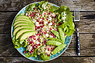 Quinoa salad with feta, pomegranate, avocado and snow peas on plate - SARF002208