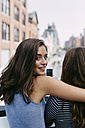 USA, New York City, two friends embracing in the city - GIOF000283