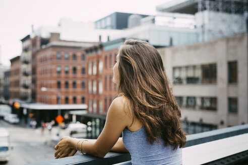 USA, New York City, young woman enjoying the view of the city - GIOF000289