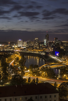 Lithuania, Vilnius, Modern town of Vilnius and Neris River at twilight - MELF000104