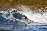 Indonesia, Lombok, surfing man - KNTF000113