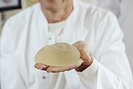 Doctor showing a silicone breast implant - MFF002369