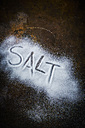 The word 'salt' written in salt on rusty metal - KSWF001649