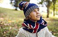 Portrait of blond boy wearing fashionable knit wear in autumn - MGOF000875