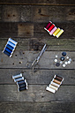 Scissors, buttons and cotton reels on wood - LVF004036