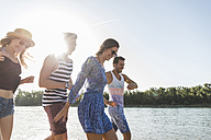 Happy friends at the river in summer - UUF005863