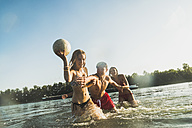 Happy friends with ball in water - UUF005896
