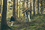 Mature man collecting mushrooms with little boy - MFF002419