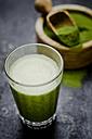 Moringa smoothie with orange and lemon juice, moringa powder in wooden bowl - CZF000225