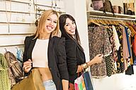 Young women in fashion boutique having fun - JASF000209