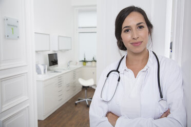 Portrait of smiling doctor at medical practice - FKF001490