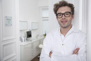 Portrait of smiling doctor at medical practice - FKF001493
