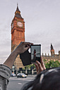 UK, London, woman taking photo of Big Ben with her smartphone - ZMF000432