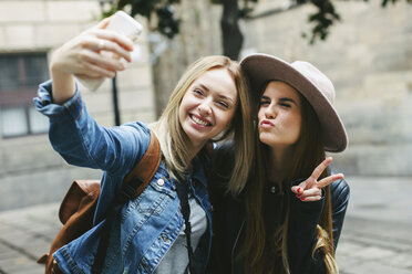 Two playful young women taking a selfie - EBSF000949