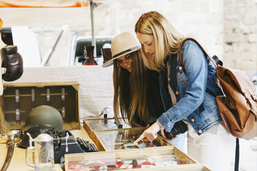 Two young women at a stall on flea market - EBSF000961