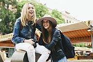 Spain, Barcelona, two happy young women in the city - EBSF000964