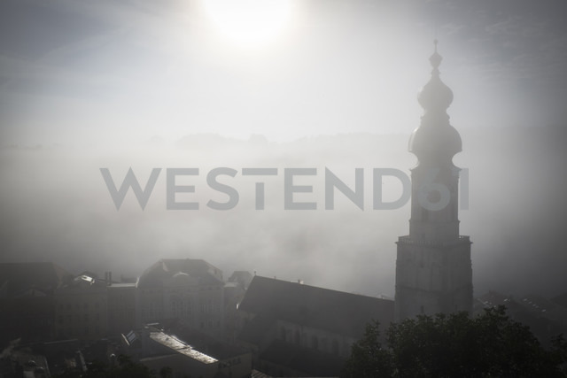 Germany, Bavaria, Burghausen, view to the old town in fog - HAM000070