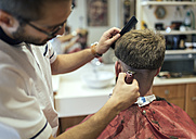 Barber shaving head of a customer - MGOF000884