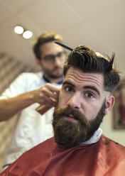 Portrait of man in a barber shop - MGOF000893