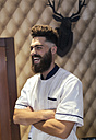 Portrait of laughing barber with full beard - MGOF000902