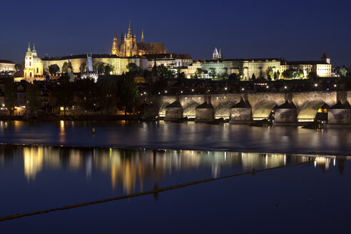 Czechia, Prague, view to lighted Prague Castle and Charles Bridge at night - OLEF000055