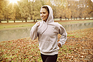 Woman jogging in park during autumn - MFF002450