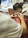 Barber shaving neck of a customer - MGOF000930