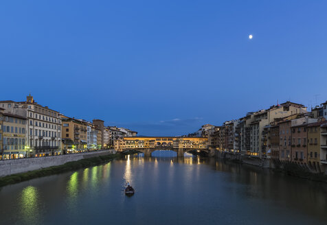Italy, Tuscany, Florence, View of Arno River and Ponte Vecchio in the evening - FOF008346