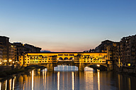 Italy, Tuscany, Florence, View of Arno River and Ponte Vecchio in the evening - FOF008349