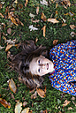 Portrait of girl lying on a meadow - MGOF000943