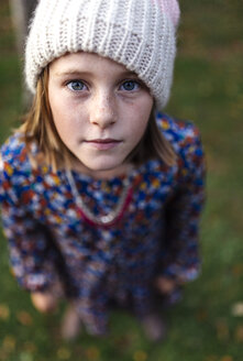 Portrait of serious looking girl wearing woollen cap - MGOF000949