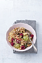 Bowl of quinoa with fruit salad and walnuts - MYF001178