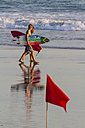 Indonesia, Bali, two surfers walking along the beach with their boards - KNTF000135