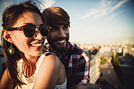 Austria, Vienna, Young couple enjoying romantic sunset on rooftop terrace - AIF000127