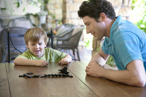 Little boy playing with his father domino - RMAF000013