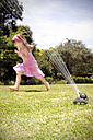 Little girl playing with lawn sprinkler in the garden - RMAF000028